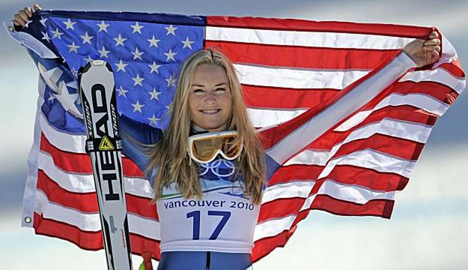 Bronze medalist Lindsey Vonn of the United States hold the Stars and Stripes during the flower ceremony for the Women's super-G at the Vancouver 2010 Olympics in Whistler, British Columbia, Saturday, Feb. 20, 2010. Photo: Gero Breloer, AP