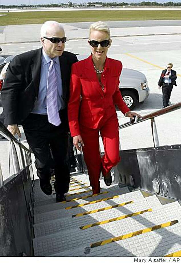"""** ADVANCE FOR WEEKEND OF AUG. 23-24 AND THEREAFTER - FILE ** In this April 28, 2008 file photo Republican, presidential candidate, Sen. John McCain, left, R-Ariz., and his wife Cindy board the campaign charter airplane in Palm Beach, Fla. ''There's nothing strategic about being passionate about something,"""" Cindy McCain has told the Associate Press when asked about her husbands outbursts of temper. """"You are or you aren't. He's a very straight shooter.""""  (AP Photo/Mary Altaffer, File) Photo: Mary Altaffer, AP"""
