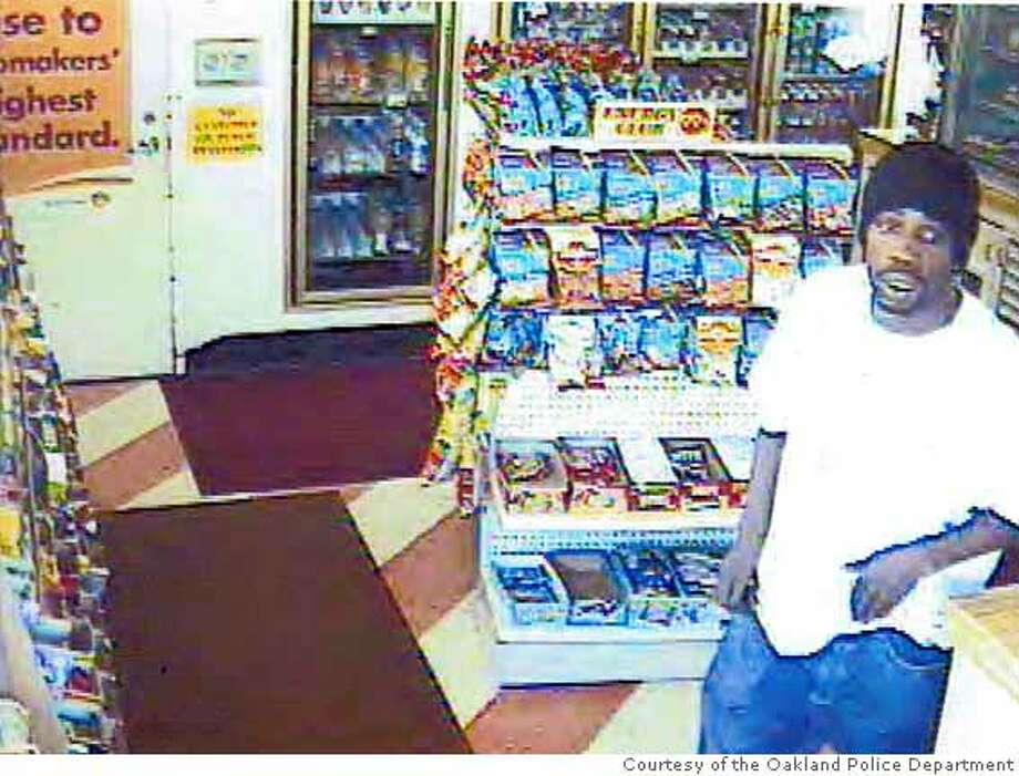 The Oakland Police Department Robbery Division released this surveillance image of the suspected Chicken Hawk bandit wanted for a string of commercial robberies. This image was from surveillance video taken at a Shell gas station on April 13, 2008 on the 3600 block of Park Boulevard in Oakland, Calif. Photo Courtesy of the Oakland Police Department Photo: Oakland Police Department
