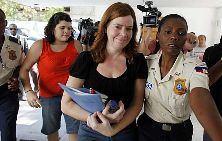 American missionary Laura Silsby, 40, center, and Charisa Coulter, 24, left, both of Meridian, Idaho, are escorted by police officers towards the courthouse in Port-au-Prince, Friday, Feb. 19, 2010. A Haitian judge has quizzed two U.S. Baptist missionaries who remain jailed on child kidnapping charges about their visits to orphanages prior to last month's earthquake. Photo: Javier Galeano, AP