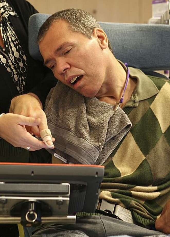FILE - In this  Nov. 24, 2009 file photo, Belgium's Rom Houben uses his touchscreen to communicate during an interview at the service center 't Weyerke in Zolder, Belgium.  It was heralded as a medical miracle. After spending more than two decades in a vegetative state, Rom Houben, a Belgian man in his mid-40s, was suddenly able to communicate, news reports trumpeted last November.   Dr. Steven Laureys, one of Houben's doctors, on Friday, Feb. 19, 2010 acknowledged that while Houben is conscious, he is not communicating. Photo: Yves Logghe, AP