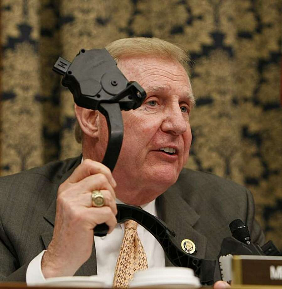 House Oversight and Government Reform Committee member Rep. Dan Burton, R-Ind., holds a Toyota accelerator pedal while asking a question of Toyota President and Chief Executive Officer Akio Toyoda, on Capitol Hill in Washington, Wednesday, Feb. 24, 2010,as he testifies before the committee. Photo: Gerald Herbert, AP