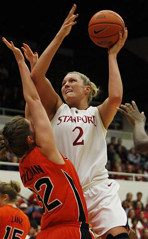 Stanford's Jayne Appel shoots as Oregon State's Kirsten Tilleman defends during the first half of an NCAA college basketball game Saturday, Feb. 20, 2010 in Stanford, Calif. (AP photo/George Nikitin) Photo: George Nikitin, AP