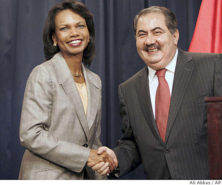 U.S. Secretary of State Condoleezza Rice, left, and Iraq's foreign minister Hoshyar Zebari, right, shake hands at a press conference in the heavily fortified Green Zone in Baghdad, Iraq Thursday, Aug. 21, 2008. U.S. Secretary of State Condoleezza Rice and Iraq's foreign minister Hoshyar Zebari said Thursday that American and Iraqi officials agree that timetables should be set for a U.S. troop withdrawal, but conceded that nailing down a broader pact on future relations is difficult. (AP Photo/Ali Abbas, Pool) Photo: Ali Abbas, AP