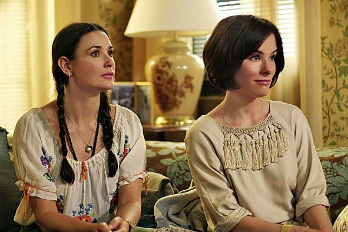 """In this film publicity image released by Roadside Attractions, Demi Moore, left, and Parker Posey are shown in a scene from, """"Happy Tears."""""""
