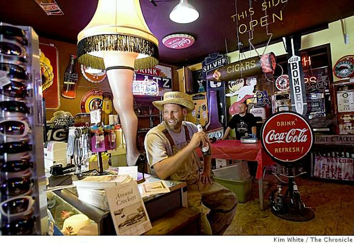 James Easterday (L) relaxes before holding a book signing of his book 'Around Crockett' in Sparky's Garage store owned by Ron McKeever in Crockett , Calif., on Saturday, August 23, 2008.