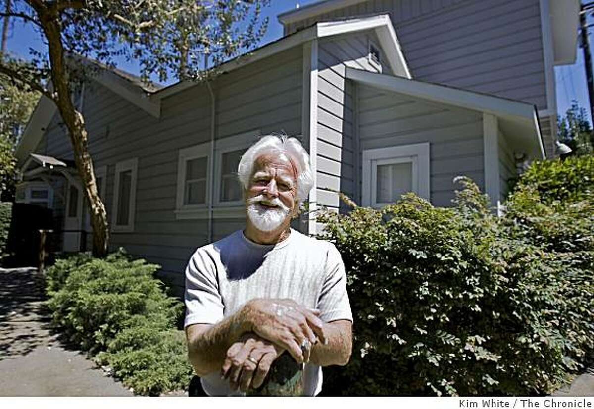 Steve Nordin, a retired mailman, stands in front the first home built by Thomas Edwards in 1867 in Crockett , Calif., on Saturday, August 23, 2008.