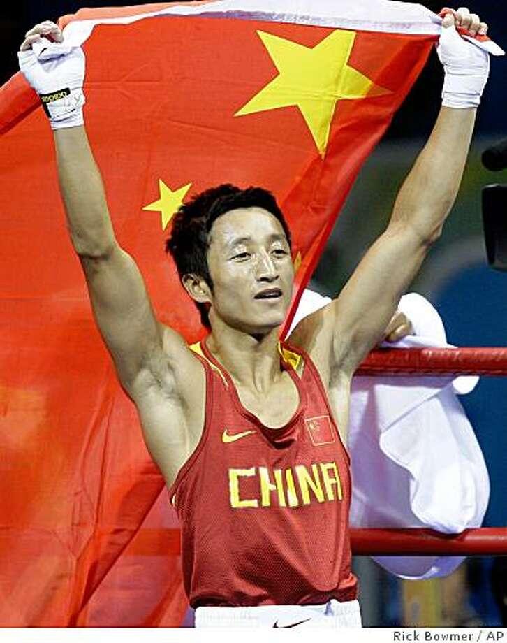 Zou Shiming of China, reacts after defeating Serdamba Purevdorj of Mongolia to win gold during the men's light flyweight 48 kilogram final boxing match at the Beijing 2008 Olympics in Beijing, Sunday, Aug. 24, 2008. Photo: Rick Bowmer, AP