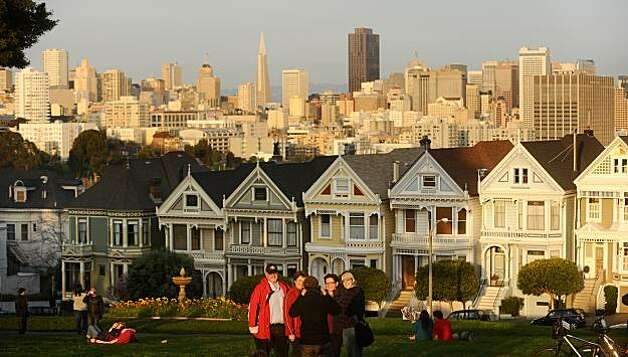 A group stops for a photo in front of the Painted Ladies on Saturday, Feb. 13, 2010, in San Francisco. Photo: Noah Berger, Special To The Chronicle