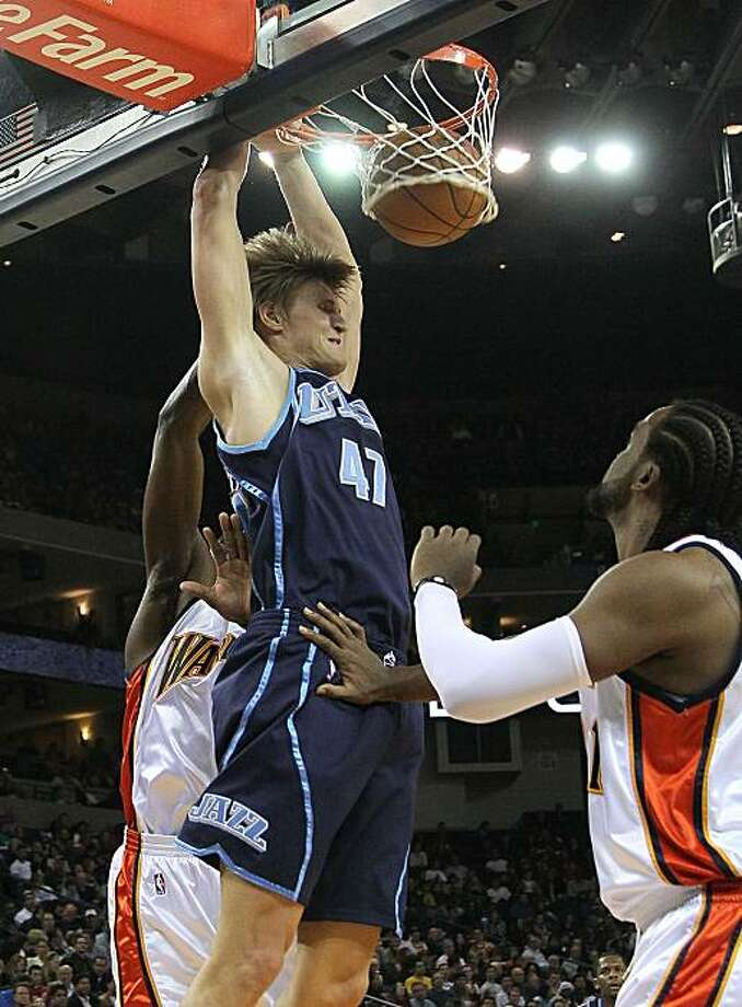 OAKLAND, CA - FEBRUARY 19:  Andrei Kirilenko #47 of the Utah Jazz shoots against Ronny Turiaf #21 of the Golden State Warriors during an NBA game at Oracle Arena at Oracle Arena on February 19, 2010 in Oakland, California. Photo: Jed Jacobsohn, Getty Images