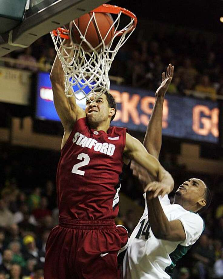 Stanford's Landry Fields, left, dunks over Oregon's Matthew Humphrey during the first half of an NCAA college basketball game Thursday, Feb. 18, 2010, in Eugene, Ore. Photo: Chris Pietsch, AP