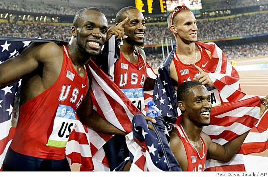 United States LaShawn Merritt, Angelo Taylor, David Neville and Jeremy Wariner, from left, celebrate winning the gold in the men's 4x400-meter relay during the athletics competitions in the National Stadium  at the Beijing 2008 Olympics in Beijing, Saturday, Aug. 23, 2008. Photo: Petr David Josek, AP