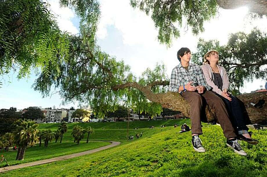 Tisha Sturman and Jeremy Sawtelle relax in Dolores Park's trees on Saturday, Feb. 13, 2010, in San Francisco. The park is slated to close for renovations. Photo: Noah Berger, Special To The Chronicle