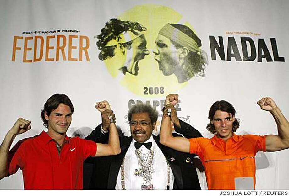 """Tennis players Roger Federer (L) and Rafael Nadal (R), and presenter Don King pose during the """"Grapple In The Apple"""" Nike event at the Mandarin Oriental Hotel in New York August 21, 2008. REUTERS/Joshua Lott (United States) Photo: JOSHUA LOTT, REUTERS"""