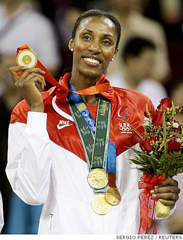 Lisa Leslie of the U.S. poses with her gold medal after the U.S. defeated Australia to win the women's basketball gold at the Beijing 2008 Olympic Games August 23, 2008.     REUTERS/Sergio Perez (CHINA) Photo: SERGIO PEREZ, REUTERS