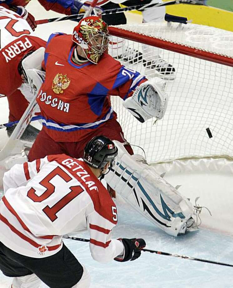 Canada's Ryan Getzlaf (51) scores a goal past Russia goalie Evgeni Nabokov (20) during the first period of a men's quarterfinal round ice hockey game at the Vancouver 2010 Olympics in Vancouver, British Columbia, Wednesday, Feb. 24, 2010. Photo: Jae C. Hong, AP