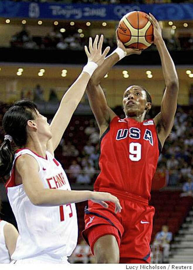 Lisa Leslie of the U.S. shoots over Chen Nan of China during their Group B women's basketball game at the Beijing 2008 Olympic Games August 11, 2008. Photo: Lucy Nicholson, Reuters
