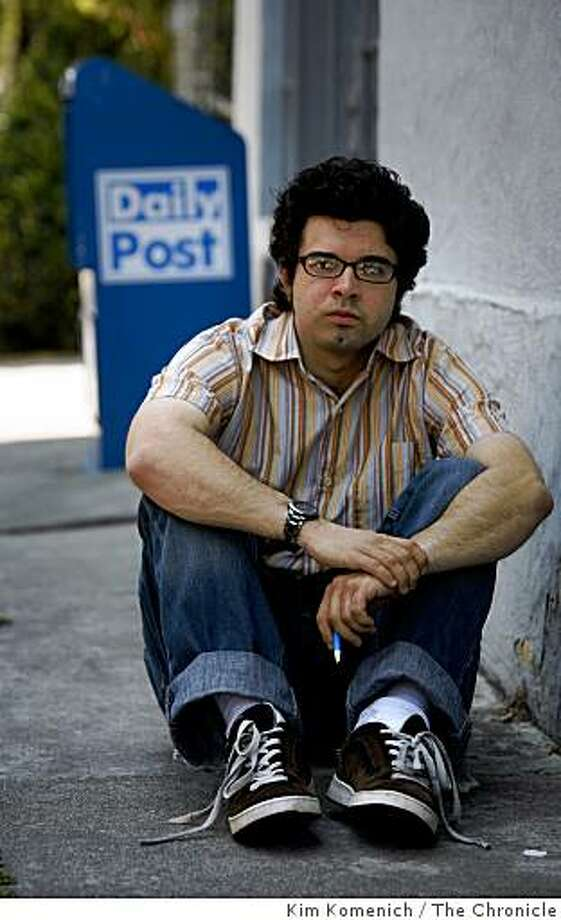 Josh Wolf, the former blogger and videographer who spent a year in federal prison for refusing to turn over a tape of a near-riot in San Francisco's Mission district. has taken a job as a reporter at the Palo Alto Daily Post. He is photographed in front of the offices of the Palo Alto, Calif. Daily Post on Wednesday, August 13, 2008. Photo: Kim Komenich, The Chronicle