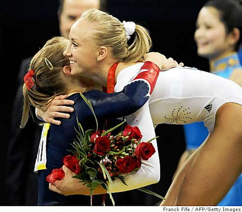 United States' Shawn Johnson (L) and her compatriot Nastia Liukin congratulate each other on the podium after the women's balance beam final at the Beijing 2008 Olympic Games in Beijing on August 19, 2008. Photo: Franck Fife, AFP/Getty Images