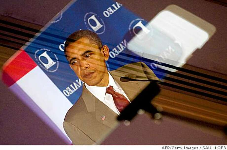 Sen. Barack Obama is reflected in his teleprompter as he speaks at the National Association of Latino Elected and Appointed Officials conference on June 28, 2008. AFP-Getty Images / Saul Loeb Photo: SAUL LOEB, AFP/Getty Images