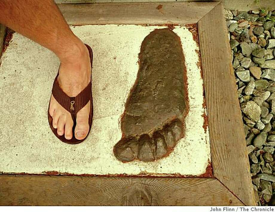 A bronze cast of one of the original Bigfoot footprint discoveries outside the Bigfoot Museum in Willow Creek. Photo: John Flinn, The Chronicle