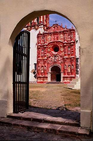 A portal leads to colorful Landa Mission. Photo: © Jeffrey Becom