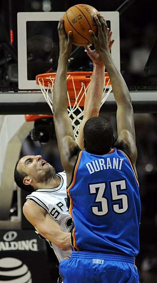 San Antonio Spurs guard Manu Ginobili, left, of Argentina, blocks a shot-attempt by Oklahoma City's Kevin Durant late in the second half of an NBA basketball game at the AT&T Center in San Antonio, Wednesday, Feb. 24, 2010. Durant scored 21 points, halting his streak of 29 straight games with 25 or more points as the Spur defeated the Thunder 95-87. Photo: Bahram Mark Sobhani, AP