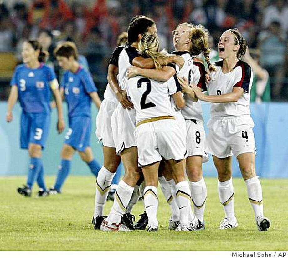 Players of the USA celebrate their side's second goal during a Beijing 2008 Olympics women's semi final soccer match between the USA and Japan in Beijing, China, Monday, Aug. 18, 2008. Photo: Michael Sohn, AP