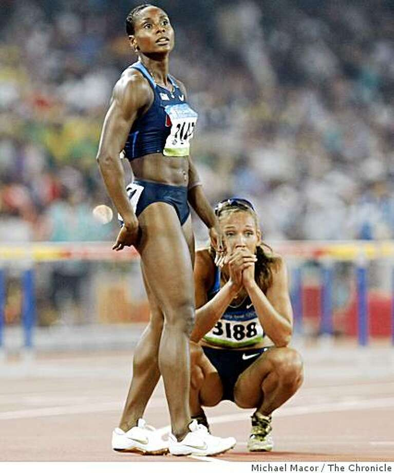 USA's Damu Cherry and Lolo Jones stare at the results board after they finished, 7th and 4th respectively in the women's 100m hurdles final at the 2008 Olympics in Beijing, China, Tuesday  Aug. 19, 2008. Photo: Michael Macor, The Chronicle