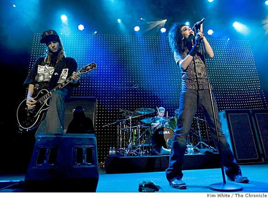 Bill Kaulitz (R), his twin brotherTom (L) and drummer Gustav Schaefer, of the German band Tokio Hotel, perform at The Filmore in San Francisco, Calif., on Tuesday, August 19, 2008. Photo: Kim White, The Chronicle