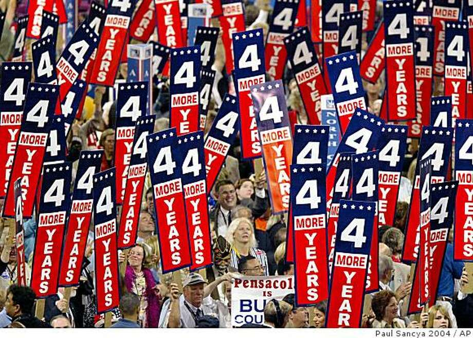 ** FILE ** In this Aug. 31,2004 file photo, delegates wave signs for President Bush after the Pennsylvania delegation announces it's support for the president at the Republican National Convention in Madison Square Garden in New York.  Modern political conventions are like a Super Bowl minus the game. They are the bling on the body politic: shiny, pretty and a touch goofy. They exist to be seen, more than to do. They are like a Miss America pageant where the fix is in. The Olympic opening and closing ceremonies without all that sweating in between. It's the party having a party. Politics is put to choreography, each song chosen for certain effect, each sign _ even the crude, seemingly spontaneous ones _ part of a script. What's the point? Is there a point somewhere in that sea of nutty hats? (AP Photo/Paul Sancya, File) Photo: Paul Sancya 2004, AP