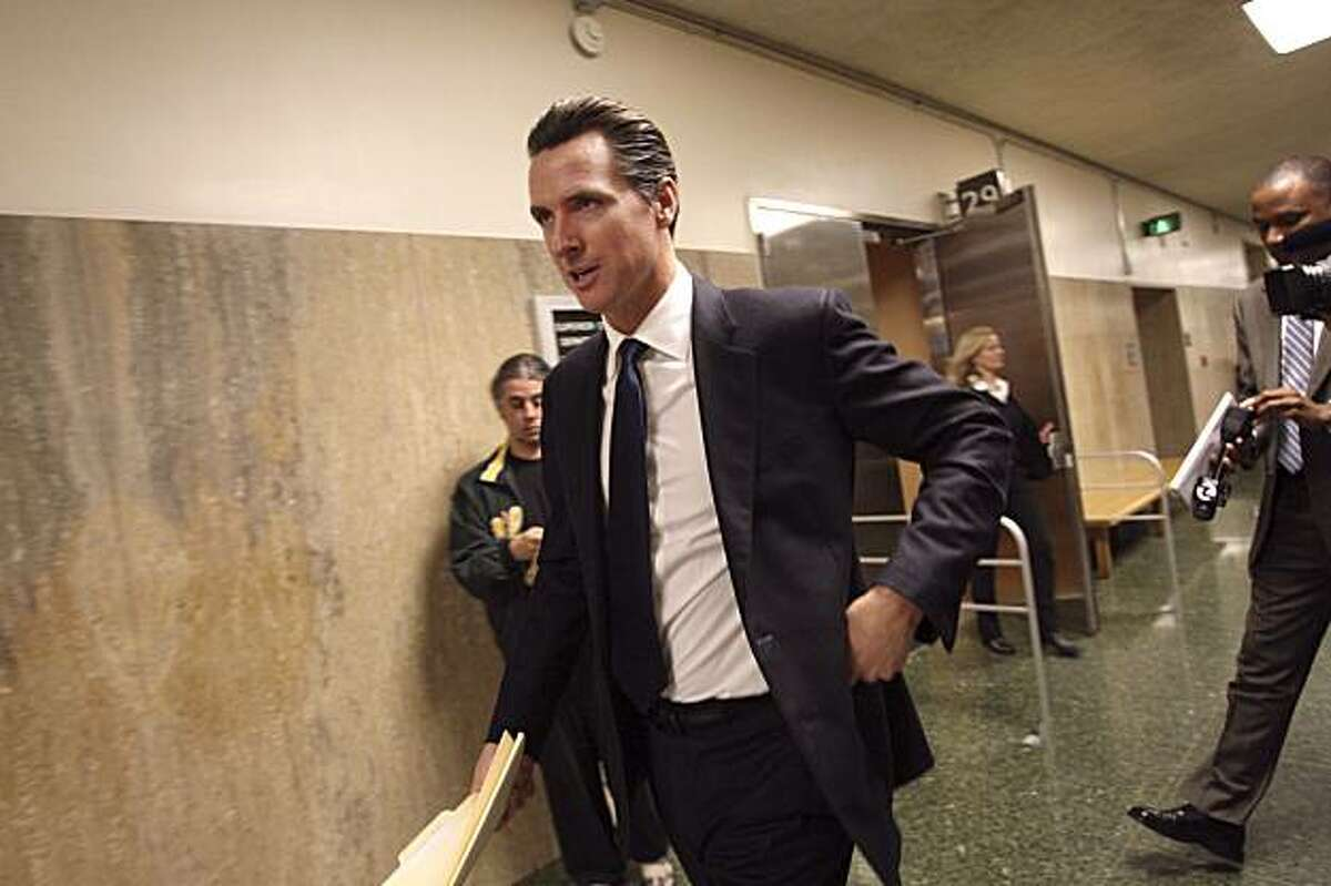 San Francisco Mayor Gavin Newsom walks out of court after testifying against Terry Childs, accused of hacking into the city's computer system in 2008, at the Hall of Justice in San Francisco on Tuesday, Feb. 23, 2010.