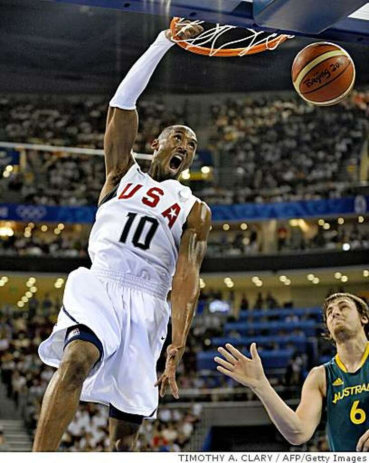 USA's Kobe Bryant dunkS during the men's quarterfinal basketball match USA vs. Australia on August 20, 2008 at the Olympic basketball arena in Beijing, as part of the 2008 Beijing Olympic Games.     AFP PHOTO / TIMOTHY A. CLARY (Photo credit should read TIMOTHY A. CLARY/AFP/Getty Images) Photo: TIMOTHY A. CLARY, AFP/Getty Images