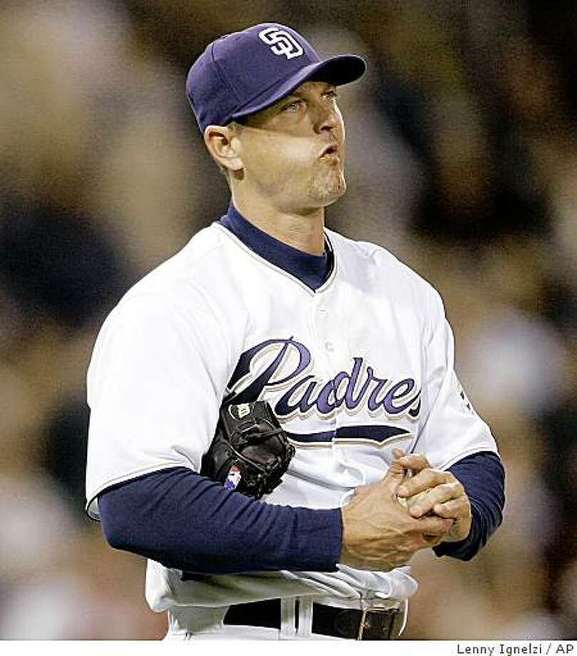 San Diego Padres  closer Trevor Hoffman rubs up a new ball after surrendering a game tying home run to San Francisco Giants' Bengie Molina in the ninth inning of a baseball game Wednesday April 23, 2008 in San Diego. (AP Photo/Lenny Ignelzi) Photo: Lenny Ignelzi, AP