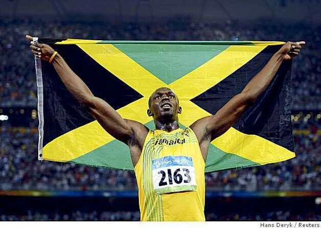 Usain Bolt of Jamaica waves his national flag after winning the men's 100m final in the National Stadium at the Beijing 2008 Olympic Games August 16, 2008. Photo: Hans Deryk, Reuters