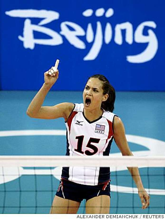 Logan Tom of the U.S. reacts during their women's preliminary Pool A volleyball match against Poland at the Beijing 2008 Olympic Games August 17, 2008.     REUTERS/Alexander Demianchuk (CHINA) Photo: ALEXANDER DEMIANCHUK, REUTERS