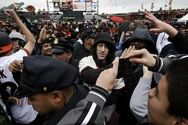 San Francisco Giants pitcher Tim Lincecum is escorted through a crowd, Saturday February 6, 2010, at the Giant's Fan Fest in San Francisco, Calif. Photo: Michael Macor, The Chronicle