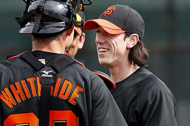 After throwing at practice, Tim Lincecum enjoyed a little baseball banter with catcher Eli Whiteside. Scenes from the San Francisco Giants and Oakland Athletics spring training campaigns of 2010 in Scottsdale and Phoenix, Arizona. Photo: Brant Ward, The Chronicle