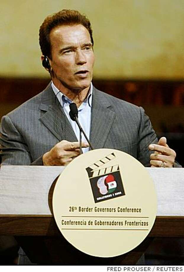 California Governor Arnold Schwarzenegger answers questions at a news conference at the conclusion of the 26th Border Governors Conference at Universal Studios in Los Angeles August 15, 2008.  REUTERS/Fred Prouser        (UNITED STATES) Photo: FRED PROUSER, REUTERS