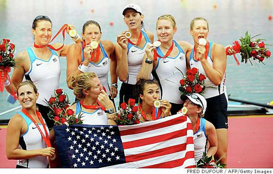 America's Erin Cafaro, Lindsay Shoop, Anna Goodale, Elle Logan, Anne Cummins, Susan Francia, Caroline Lind, Caryn Davies and Mary Whipple celebrate during the medals ceremony for the women's eight at the Shunyi Rowing and Canoeing Park in Beijing  on August 17, 2008.  The US won gold, Netherland Silver and Romania bronze.   AFP PHOTO / FRED DUFOUR (Photo credit should read FRED DUFOUR/AFP/Getty Images) Photo: FRED DUFOUR, AFP/Getty Images