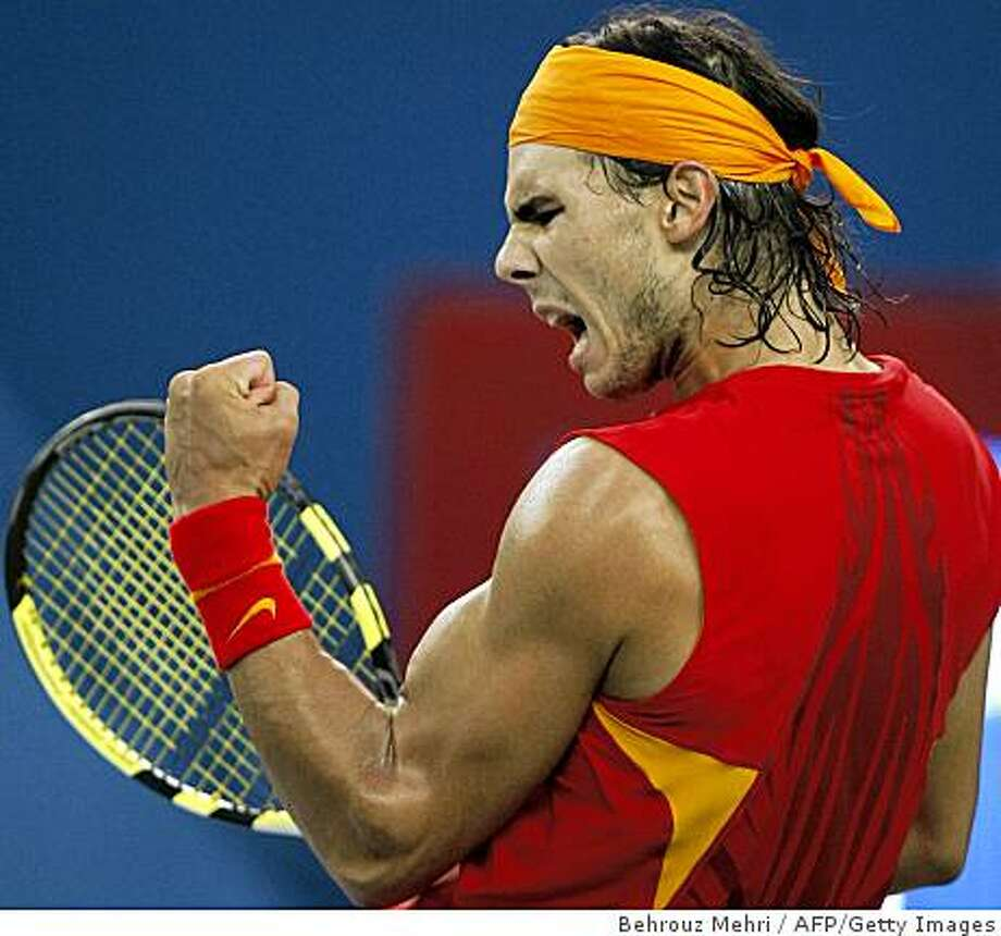 Rafael Nadal of Spain pumps his fist after winning a point against Fernando Gonzalez of Chile in their men's singles gold medal final tennis match during the 2008 Beijing Olympic Games on August 17, 2008. Photo: Behrouz Mehri, AFP/Getty Images