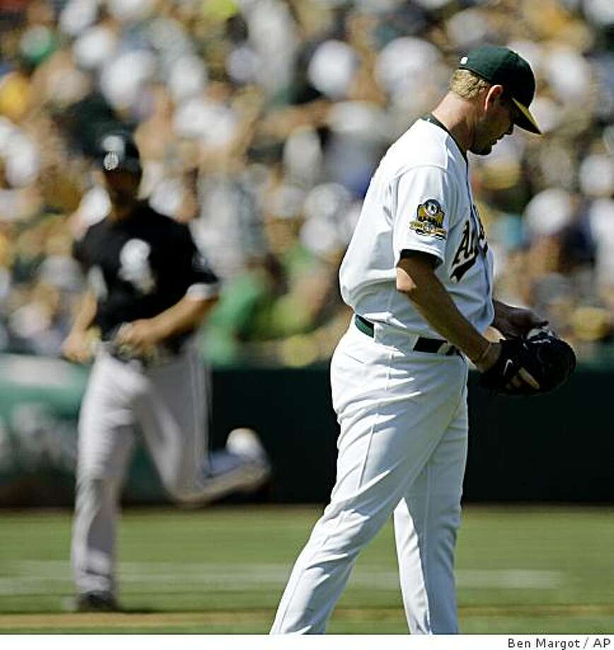Oakland Athletics' Dan Meyer, right, waits for the bases to clear after giving up a grand slam to Chicago White Sox's Alexei Ramirez during the seventh inning of a baseball game Sunday, Aug. 17, 2008, in Oakland, Calif. (AP Photo/Ben Margot) Photo: Ben Margot, AP