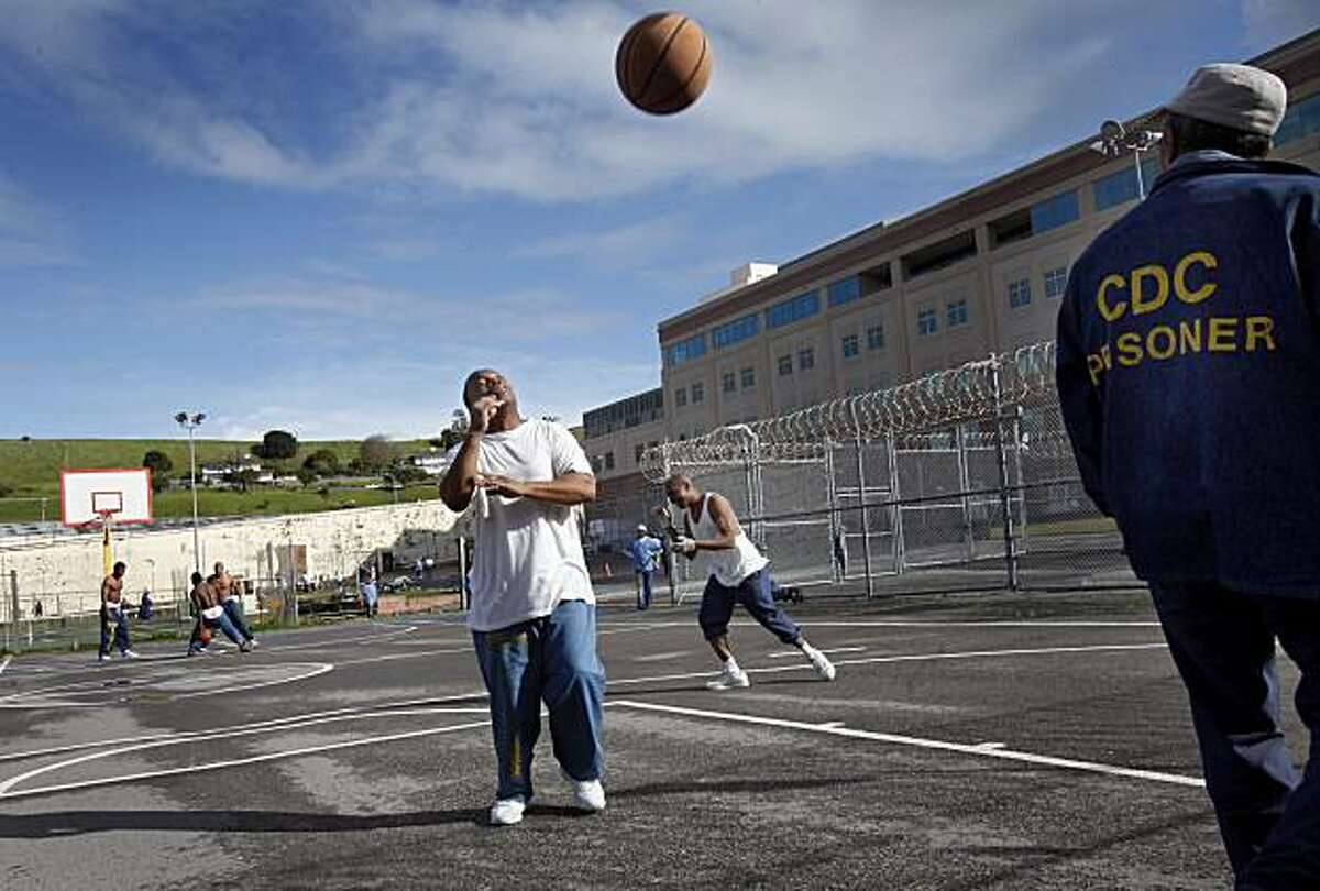 """San Quentin inmate James Taylor (left) and Walter Ridley enjoyed a sunny day on the recreation yard at the prison Tuesday February 9, 2010. They are both in prison for """"three strike"""" violations and dislike the idea of fewer educational and vocational opportunities. A new California law aimed at cutting prison spending includes the cutting of education and vocational spending at San Quentin (Marin County) and other state prisons."""