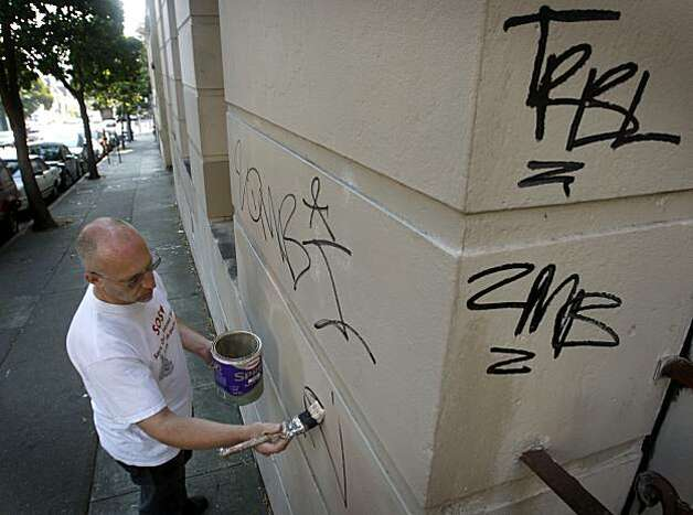 In this file photo, Parishoner Robert Pritchard paints over graffiti tagged on the Fell Street side of Sacred Heart Catholic Church in San Francisco. Photo: Paul Chinn, The Chronicle