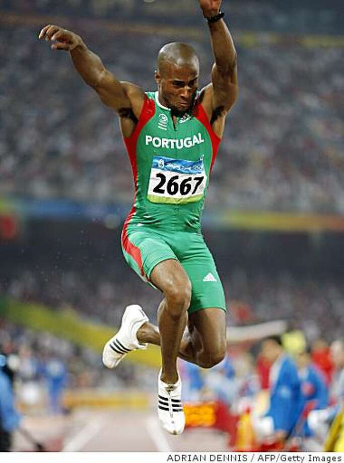Portugal's Nelson Evora competes during the men's triple jump final at the National Stadium in the 2008 Beijing Olympic Games on August 21, 2008.  AFP PHOTO / ADRIAN DENNIS (Photo credit should read ADRIAN DENNIS/AFP/Getty Images) Photo: ADRIAN DENNIS, AFP/Getty Images