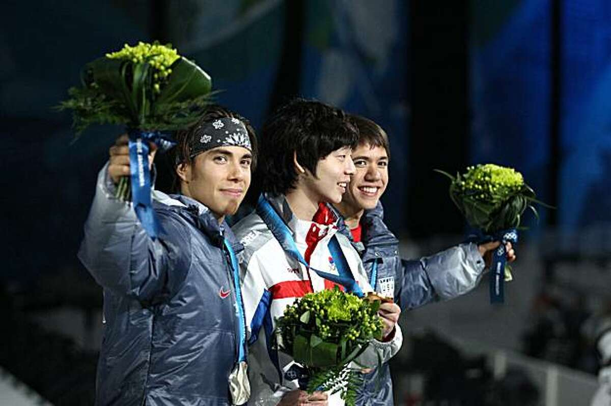 From left, USA silver medalist Apolo Ohno, Korean gold medalist Ho-Suk Lee and USA bronze medalist J.R. Celski stand on the podium during the medal ceremony for the men's 1,500m short-track speed-skating event at the Winter Olympics in Vancouver, Canada, on Sunday, February 14, 2010. (John Lok/Seattle Times/MCT)