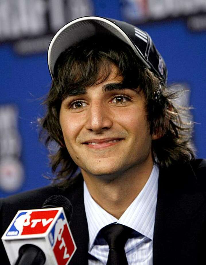 FILE -- This June 25, 2009 file photo shows Ricky Rubio, of Spain, taking questions in the interview room after being selected by the Minnesota Timberwolves as the fifth pick in the first round of the NBA basketball draft, in New York. Some marketing experts say a relocation to the United States and the NBA could bring the 18-year-old point guard many more riches. (AP Photo/Jason DeCrow, File) Photo: Jason DeCrow, AP