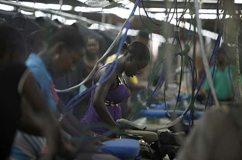 In this photo taken Feb. 19, 2010, Women work at the DKDR Haiti garment assembly factory in Port-au-Prince.  The international community and business leaders are preparing to implement a pre-earthquake plan to expand the garment assembly sector for a country in urgent need of building it's economy. Photo: Javier Galeano, AP