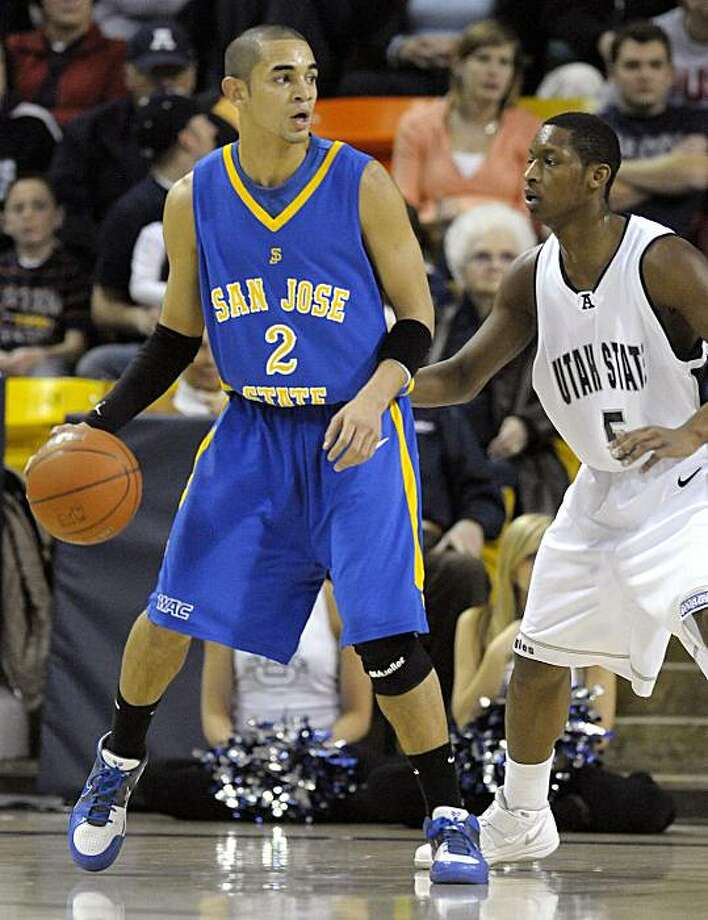 San Jose State's Adrian Oliver is guarded by Utah State's Pooh Williams during the first half of an NCAA college basketball game in Logan, Utah, on Saturday, Jan. 30, 2010. Photo: Braden Wolfe, AP