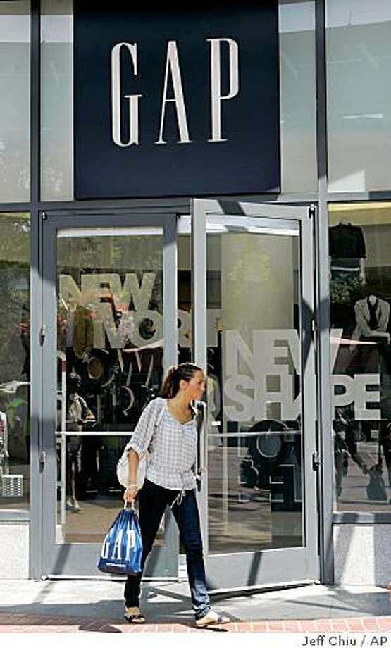 A woman leaves a Gap store in San Francisco, Friday, Aug. 15, 2008. Apparel maker Gap Inc. reports earnings for its fiscal second quarter after the market close Thursday, Aug. 21, 2008. (AP Photo/Jeff Chiu) Photo: Jeff Chiu, AP